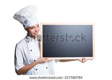 young smiling cook with a blackboard - stock photo