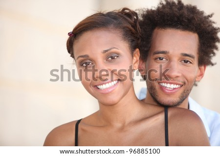 Young smiling couple - stock photo