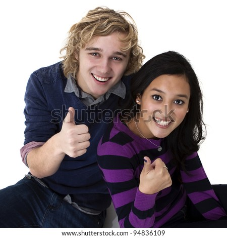 young smiling couple giving the thumbs up