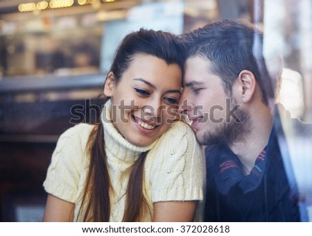 Young smiling couple hugging in the cafe. - stock photo