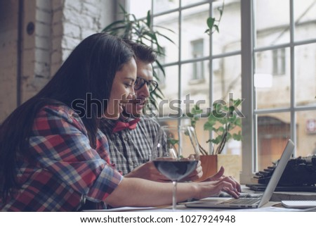 Young smiling couple in a cafe