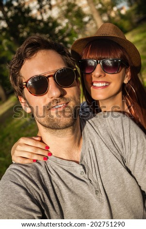 Young Smiling Couple Making A Self Portrait - stock photo