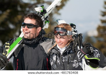 Young smiling couple on a skiing vacation