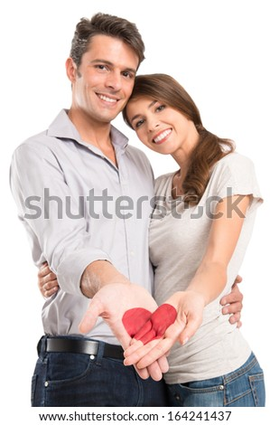 Young Smiling Couple With Heart Painted On Hand Isolated On White Background