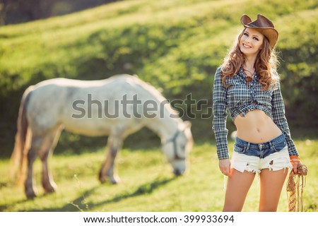 Young Smiling Cowgirl and Horse Outdoors. Sexy Fashion Model - stock photo
