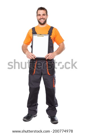 Young smiling engineer holding black folder, isolated on white background - stock photo
