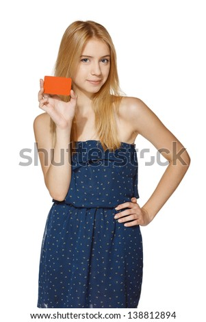 Young smiling female holding blank credit card, over white background - stock photo