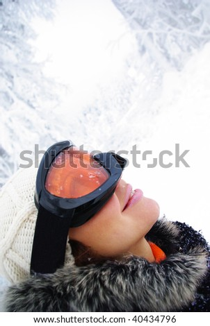 Young smiling  female skier - stock photo