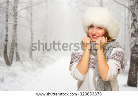 Young smiling girl at winter forest - stock photo