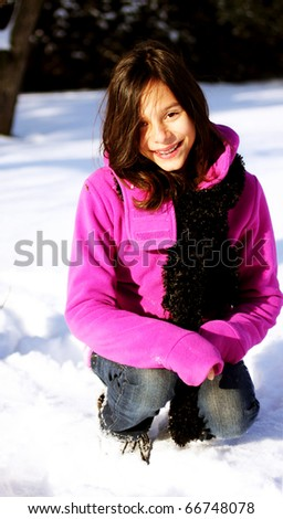 Young smiling girl during a hike in winter forest landscape, - stock photo
