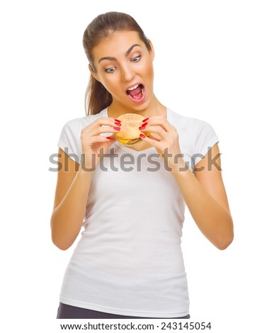Young smiling girl eat hamburger isolated - stock photo