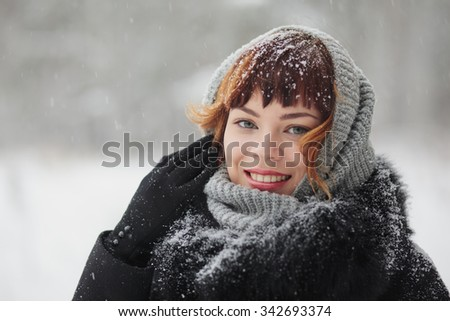 Young smiling girl in winter forest