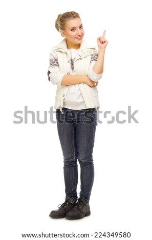 Young smiling girl shows pointing gesture isolated - stock photo