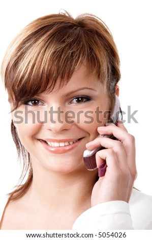 Young smiling girl speaking on the telephone isolated at the white background