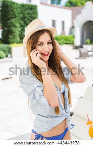 young smiling girl using a phone, talking