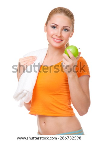 Young smiling girl with apple isolated - stock photo