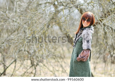 Young smiling girl with sunglasses outdoors - stock photo
