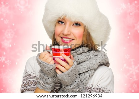 Young smiling girl with sweater and mug - stock photo
