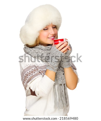 Young smiling girl with sweater and mug isolated - stock photo
