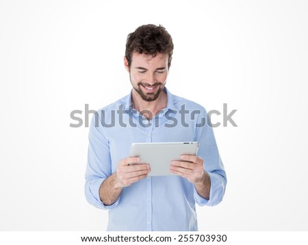 young smiling guy have fun with his new technological toy - stock photo