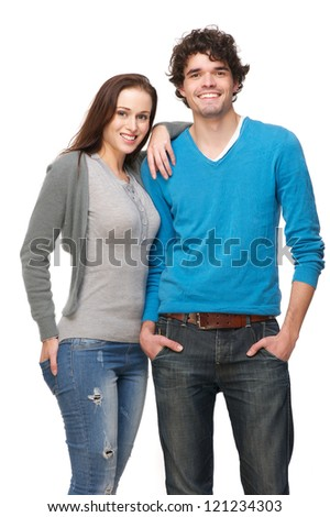 Young smiling happy couple isolated on white background. Boyfriend and girlfriend are in a relaxed pose and laughing.