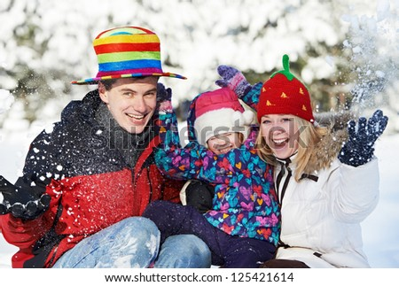 young smiling happy family with child at winter snow outdoors - stock photo