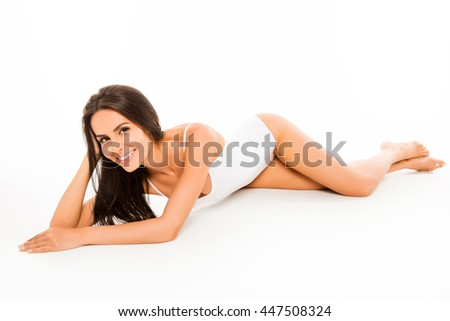 Young smiling happy girl lying in white underwear
