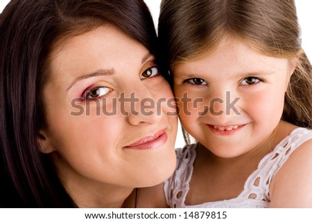 Young smiling happy mother and beautiful daughter