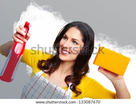 Young smiling housewife. Housework background. - stock photo