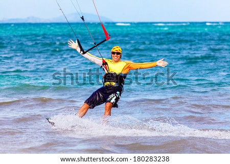 young smiling  kite surfer on tropical sea background Extreme Sport Kite surfing - stock photo