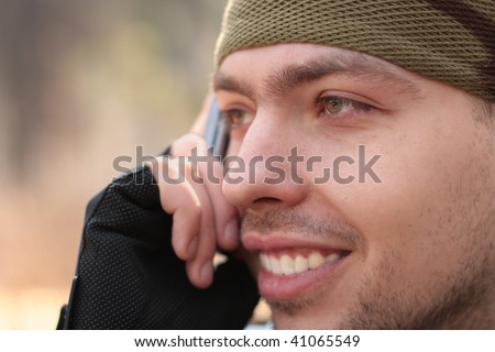 young smiling man calling phone