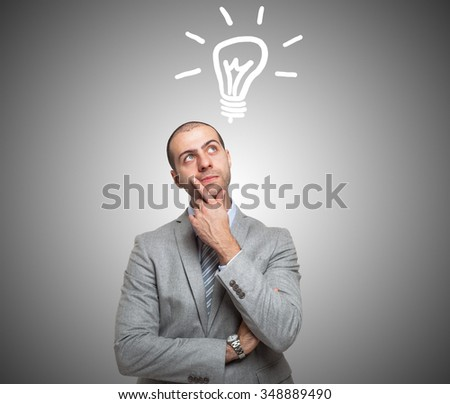 Young smiling man having a good idea - stock photo