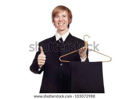 Young smiling man holding a hanger isolated on white - stock photo