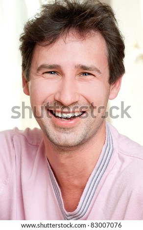 young smiling man indoors