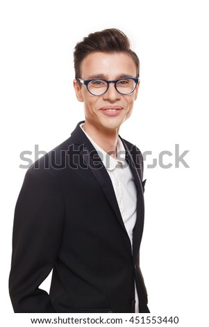 Young smiling man isolated at white. Portrait of confident guy looking at camera. Boy style, trendy male person in stylish eyeglasses and black suit. Modern businessman. - stock photo