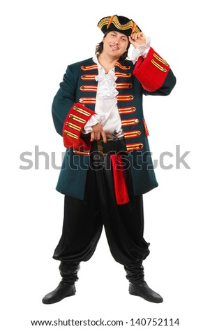 Young smiling man wearing pirate costume. Isolated on white - stock photo