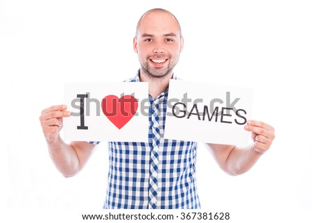 Young smiling man with banner I love - stock photo