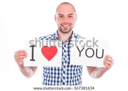 Young smiling man with banner I love you - stock photo