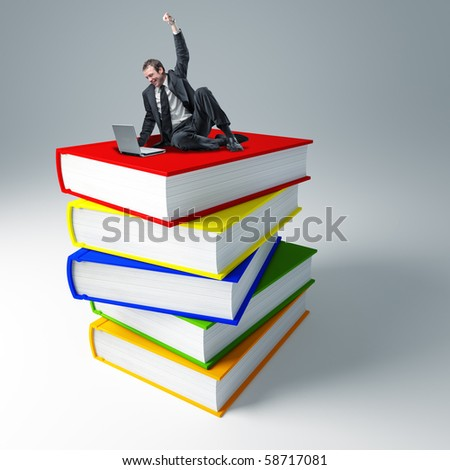 young smiling man with laptop sit on 3d huge virtual book - stock photo