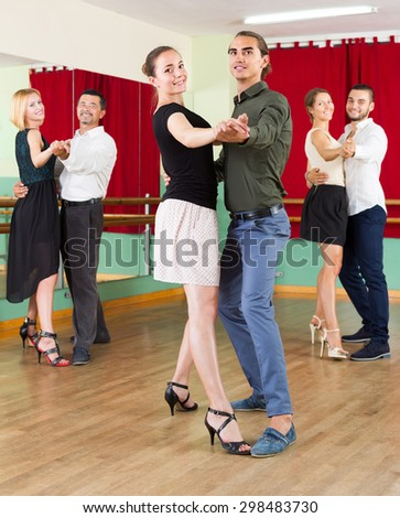 Young smiling people having dancing class   - stock photo