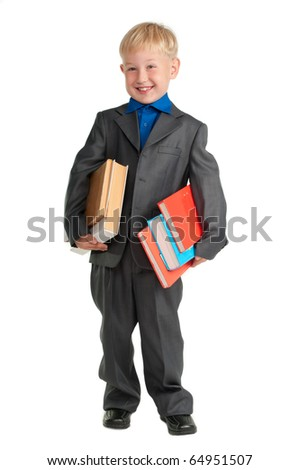 Young smiling schoolboy holding heavy books in his arms