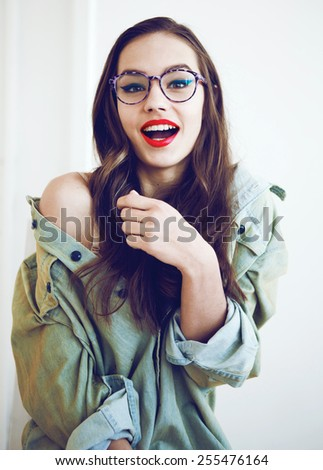 Young smiling sexy brunnete woman with sunglasses, wearing in jeans shirt - stock photo