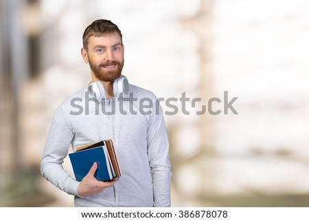 Young smiling student with books