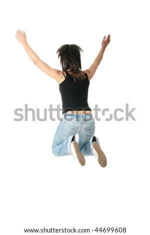 Young smiling student woman jumping. Isolated on white background