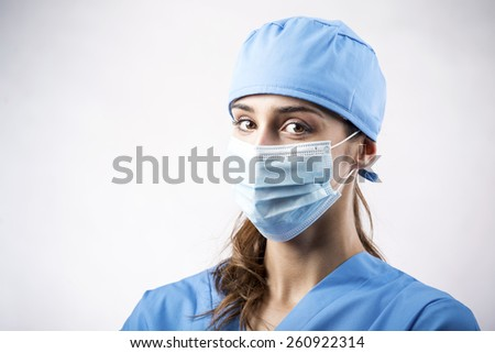 Young Smiling Surgeon in Blue Uniform.