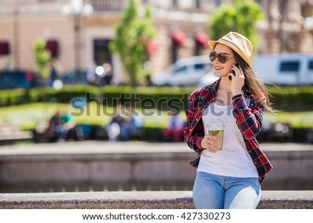 Young smiling teen happy woman making selfie on the street