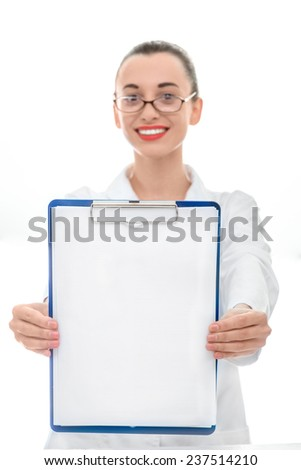 Young smiling woman doctor holding empty foulder and looking at camera on white background
