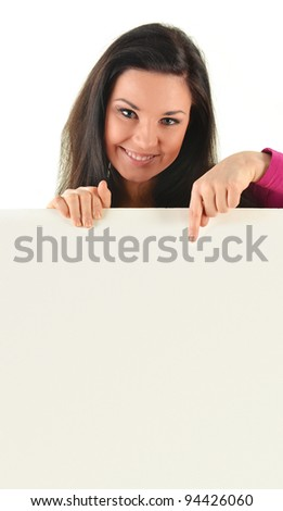 Young smiling woman holding a blank board isolated on white background