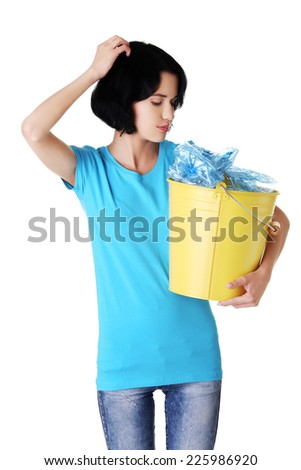 Young smiling woman holding a bucket - stock photo