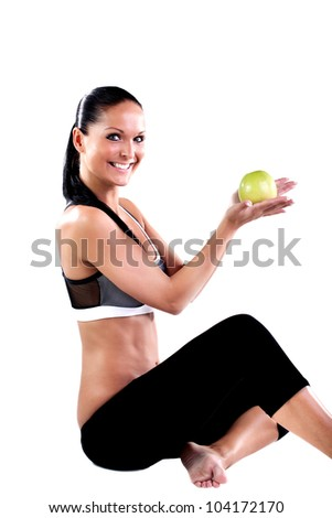 Young smiling woman holding apple - stock photo